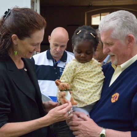 Josiane receiving a Kangaroo from Manda and Bob (Lions Members)