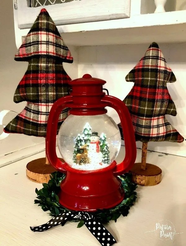 red lantern snow glove and plaid trees