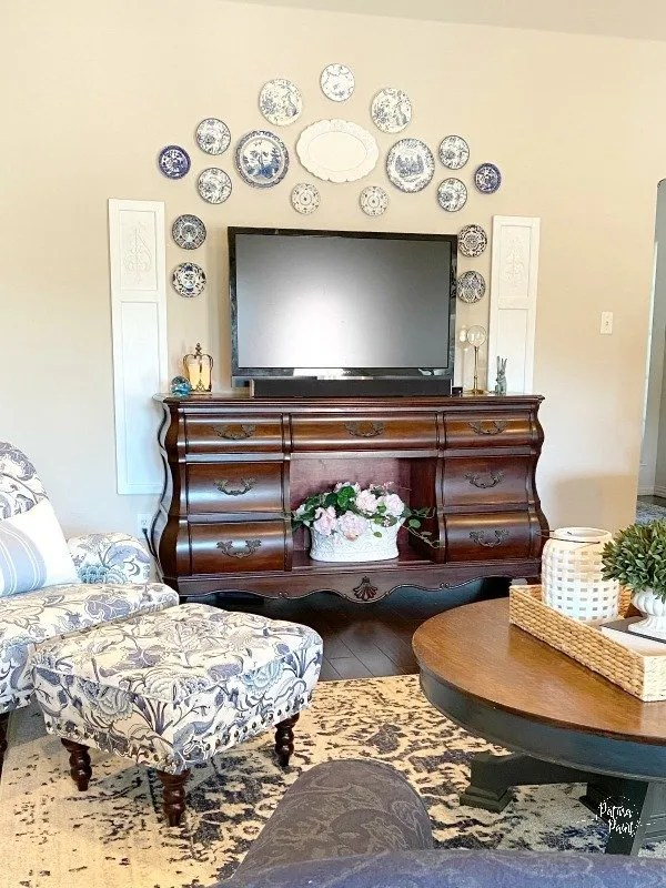 blue and white living room with tv
