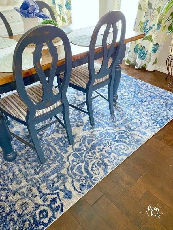 blue and white rug, dining table and chairs