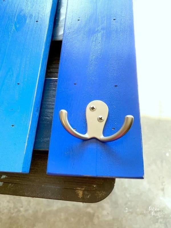 blue board, coat hook