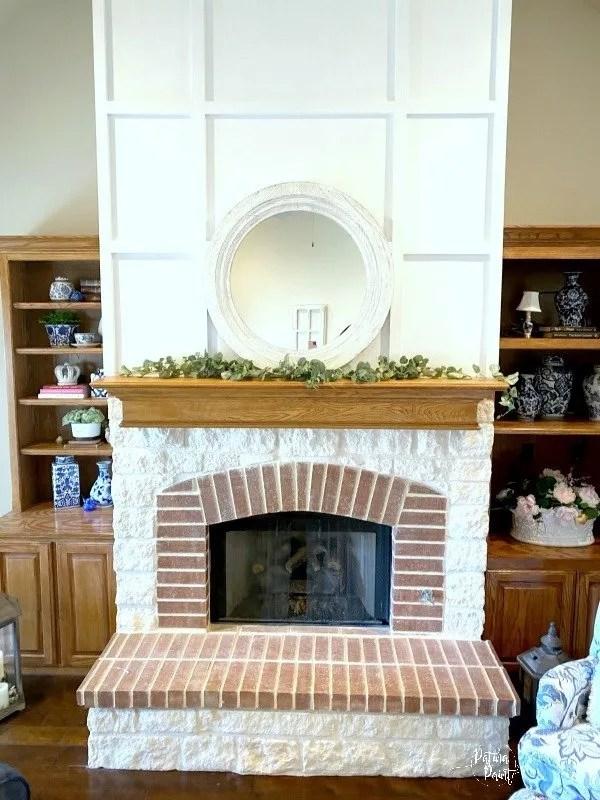 white mirror on fireplace