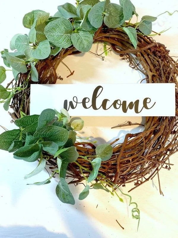 welcome sign on grapevine wreath
