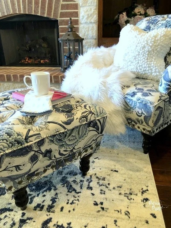 pillow, fireplace, chair and throw