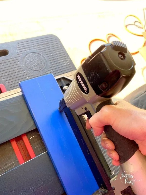 nail gun, blue board