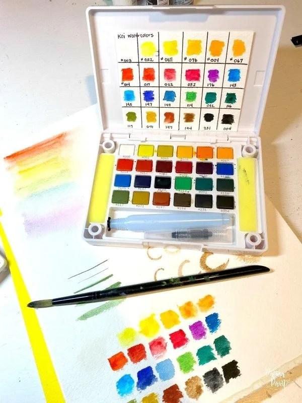 water color kit, paper, and brush