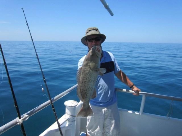 Man Caught Big Fish - Deep Sea Fishing in Tarpon Springs, FL