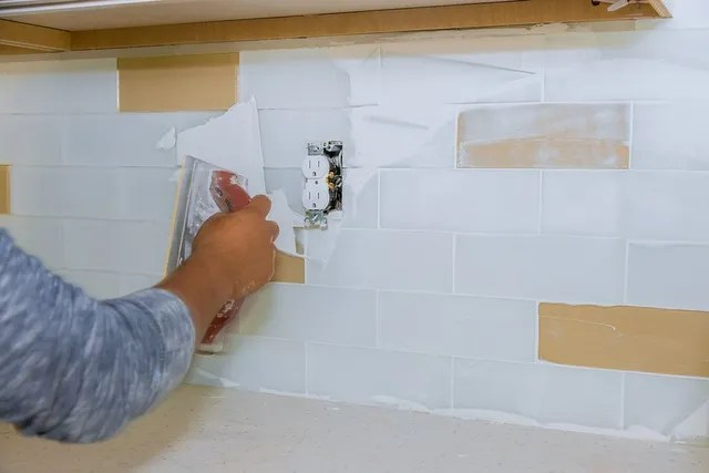 grouting and caulking bathroom tiling