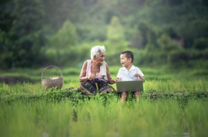 Grandmother and Child Share a Laptop