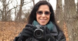 Lisa-Michelle Kucharz hiking with camera.