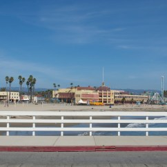 Walking back on the wharf, looking at the Santa Cruz boardwalk, complete with a roller coaster and ferris wheel