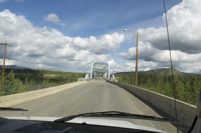 If memory serves correct, this was the bridge at Carmacks over the Yukon River. Pierre Berton said in his Drifting Home book, that this bridge is too low and will never allow steamboats to travel down the Yukon again.