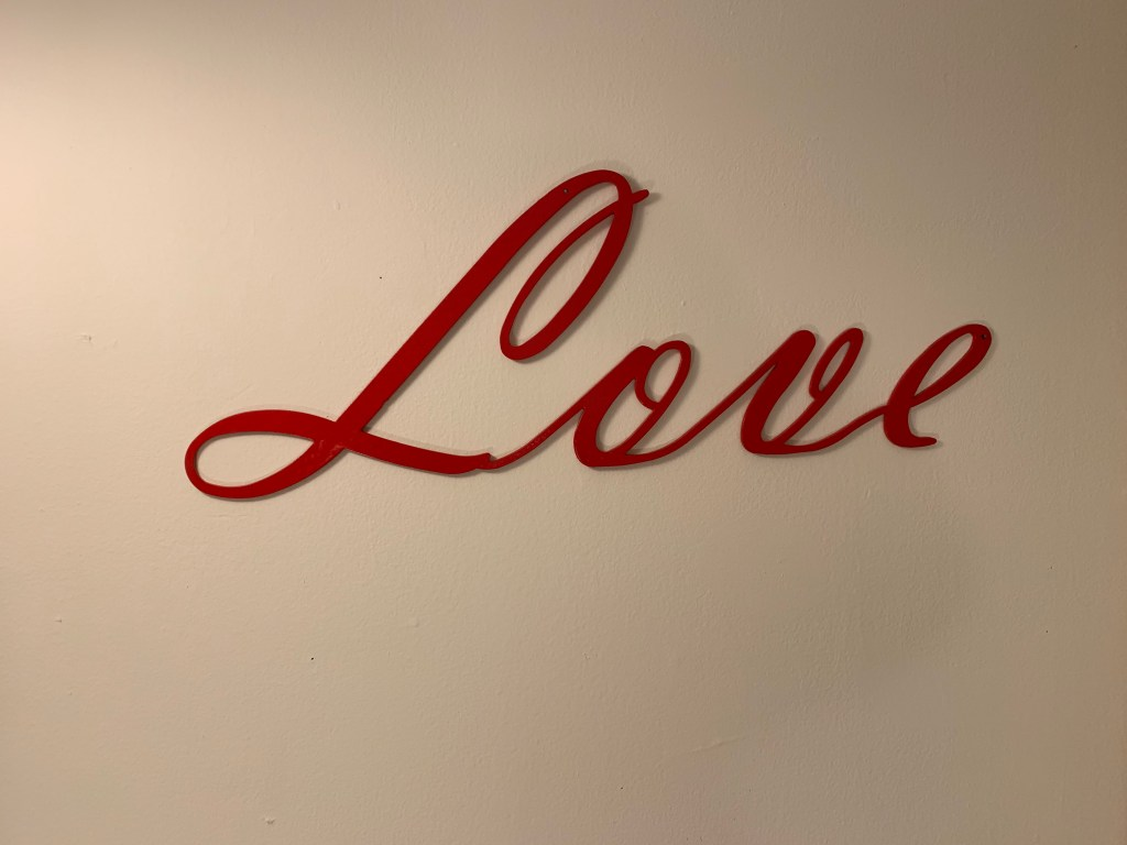 Metal sign that says LOVE.