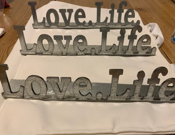 Photo of Love.Life. table top metal signs