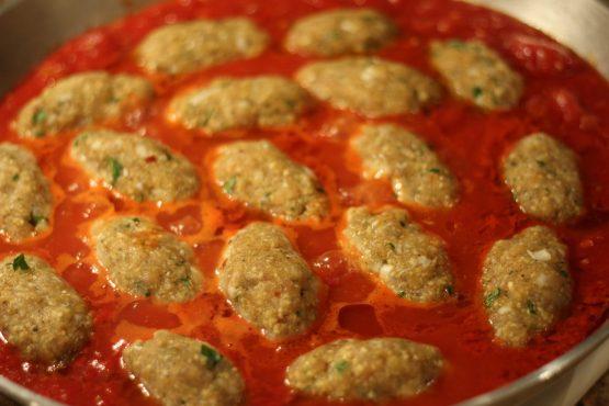 fish balls simmering in paella pan