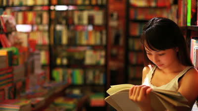 Image result for reading in a bookstore