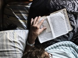 My father reading his Bible in the mornings.