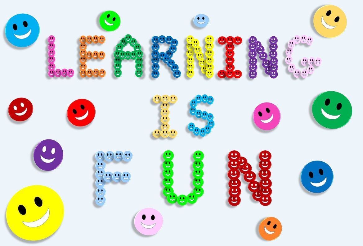Smiley faces arranged to spell out learning is fun