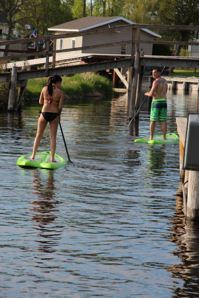 Lauren and Jake, trying out the paddle boards down the channel
