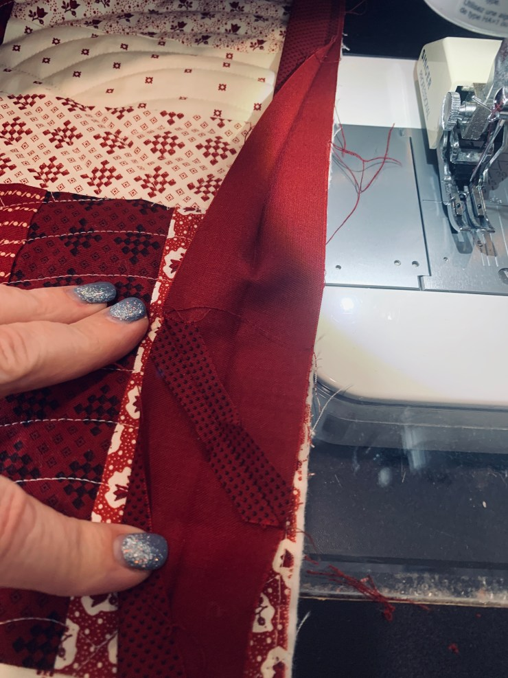 How to attach a quilt sleeve & binding to a quilt, a tutorial featured by top US quilting blogger, Lisa Bongean