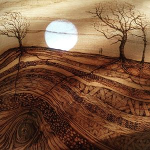 Romantic pyrography / wood burning, irish landscape with white moon and trees, two small figures.