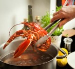 removing cooked lobster from the pan