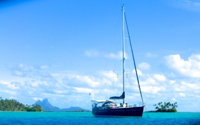 Amandla Anchored Off Ile Tautau in Taha'a, French Polynesia with Bora Bora in the Distance