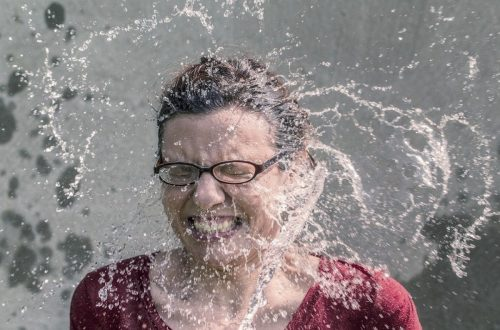 Woman splashed with water