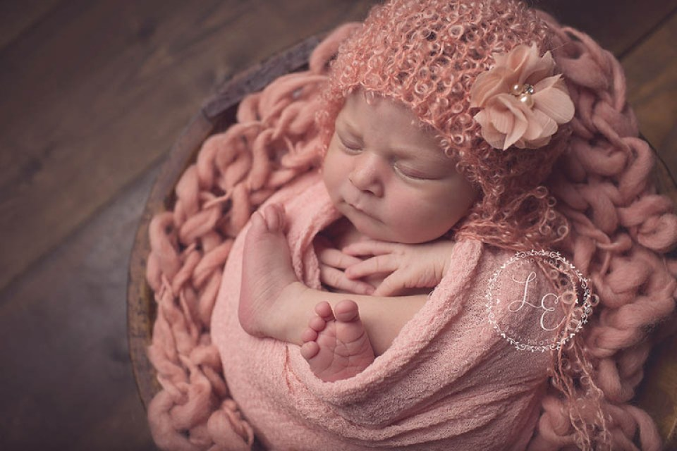 wrapped baby girl with cute hat