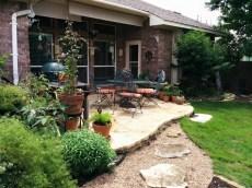 Limestone patio, river rock sidewalk