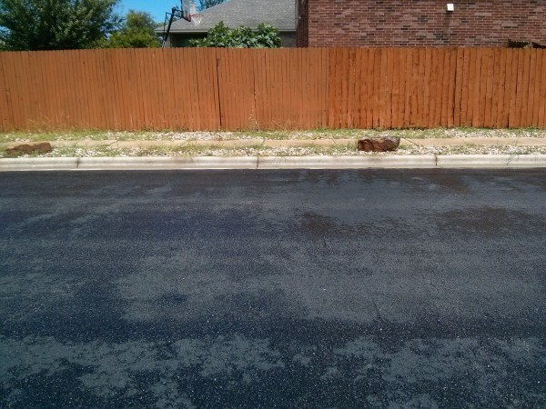 Yikes!  Someone underestimated the amount of work that goes into having rock in the nuisance strip!