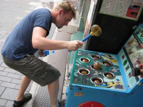 man playing Whack-a-mole
