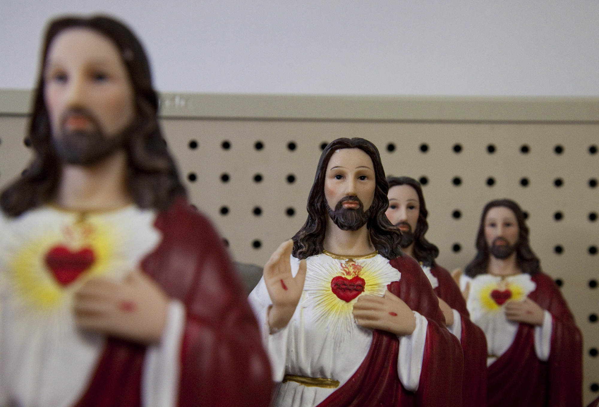 Jesus statuettes sit on a shelf, for sale at $33.99 at the Atlantic Farmers' Market.