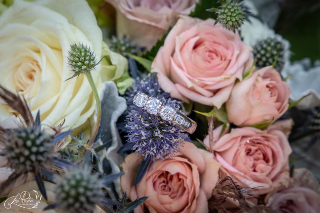 Diamond rings in bridal bouquet