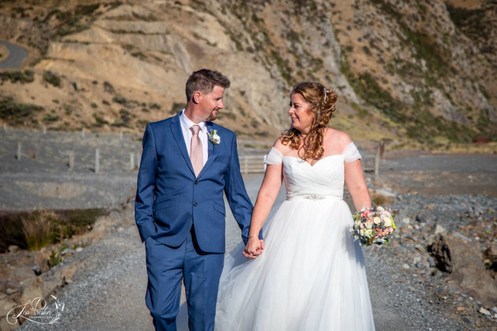 Bride and groom coastal walk, Pencarrow Coast