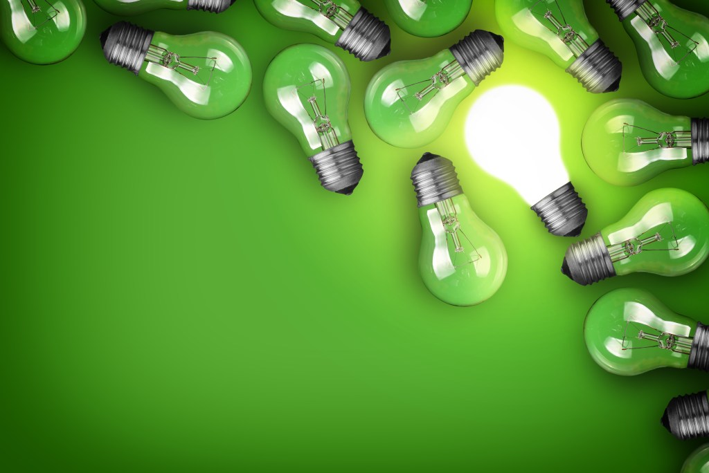 Idea concept photo of light bulbs on a green background