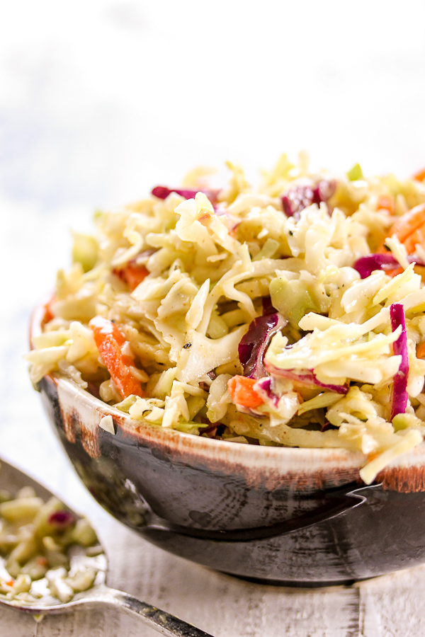 This mayo free coleslaw takes just minutes to prepare and is full of tangy, delicious flavor.  It's a perfect addition to any backyard BBQ or picnic.