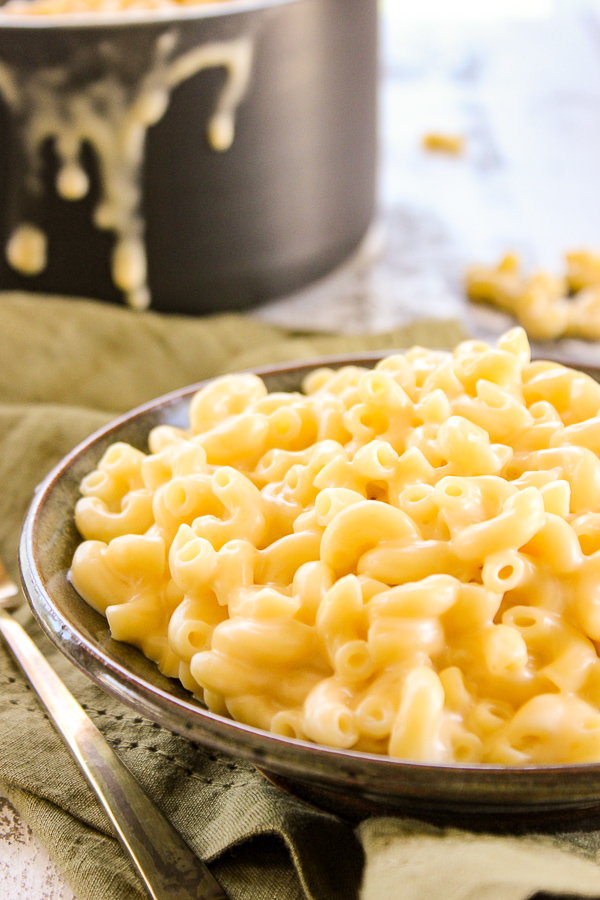 Stove top macaroni and cheese is easy, creamy and so, so cheesy. Once you make it, you'll never want store bought again.