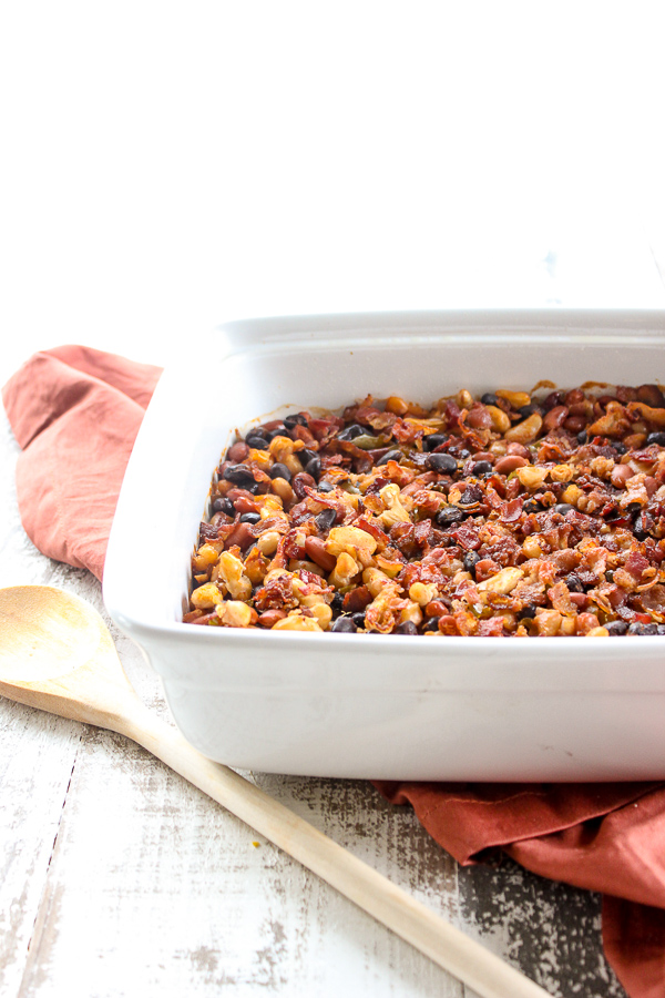 Smoky three bean bake is sure to be a hit at any summer barbecue or potluck. It's easy to prepare ahead of time and the sweet and smoky flavors are sure to be a crowd pleaser.