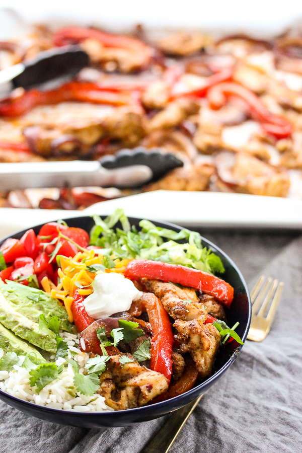 Sheet Pan Chicken Fajita Bowls are a healthy one pan wonder that take almost no time to prepare and are full of incredible Mexican flavor.