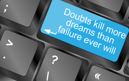 Doubts kill more dreams than failure ever will. Computer keyboard keys with quote button. Inspirational motivational quote. Simple trendy design
