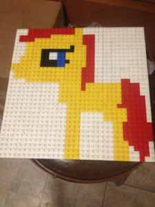 A simple engaging activity for kids to do while you work is to build a Lego flat picture