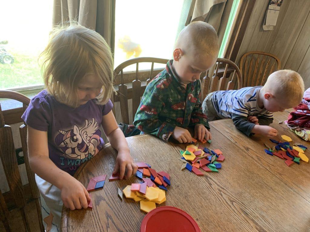 Kids playing with pattern blocks.