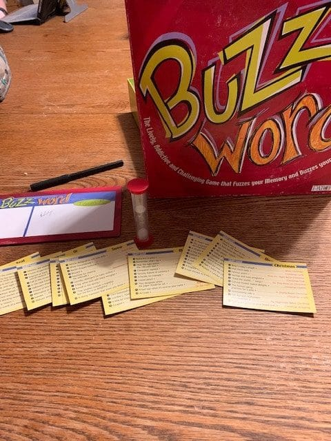 Here is the game Buzzwords with some of the pieces in front of the box. It's one of the best board games for freelance writers.