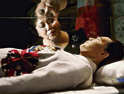 Former First Lady of the Philippines Imelda Marcos kisses the crystal coffin of her deceased husband, former President Ferdinand Marcos