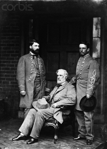Confederate General Robert E. Lee, seated, with 2 of his officers, photographed by Mathew Brady in April, 1865, following Lee's surrender to General Ulysses S. Grant at the Appomattox Court House in Richmond, Virginia.