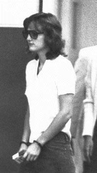 1975 photo of Patty Hearst, handcuffed, in custody