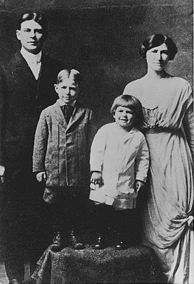 """A photograph of Ronald Reagan as a young child. He is standing between his mother and older brother, Neil. Notice his Dutchboy haircut, from which he got the nickname, """"Dutch."""""""
