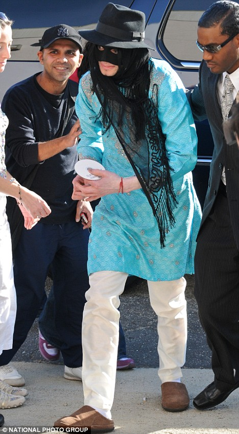 Toward the end of his life, Michael Jackson made the headlines more often for his odd behavior than for his musical accomplishments. In this 2008 photo, Michael at age 50, appears in another bizarre disguise, a veil, an eye mask, and his trademark black trilby hat