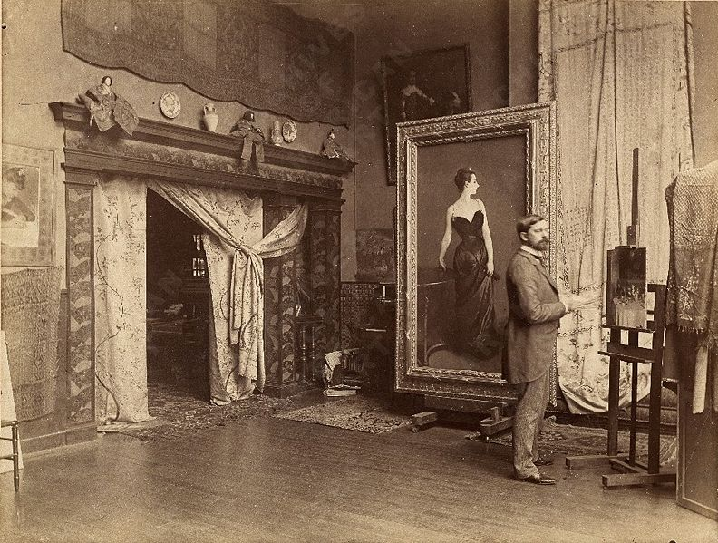 John Singer Sargent in Paris studio 1885 with the revised painting of Madame X